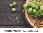 white grapes on natural wood... | Shutterstock . vector #670807066