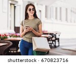 beautiful young woman with... | Shutterstock . vector #670823716