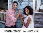 portrait of happy couple... | Shutterstock . vector #670825912