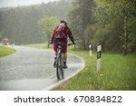 man drives on the bicycle in... | Shutterstock . vector #670834822