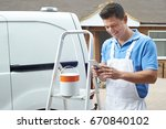 decorator using mobile phone... | Shutterstock . vector #670840102