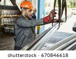 young bearded worker in a... | Shutterstock . vector #670846618