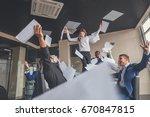 business team celebrating a...   Shutterstock . vector #670847815