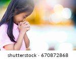 girl praying on the morning in... | Shutterstock . vector #670872868