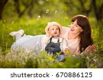 beautiful young mother and... | Shutterstock . vector #670886125