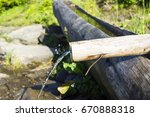 water from mountain spring is... | Shutterstock . vector #670888318