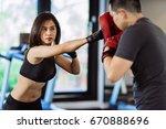 asian women sport boxing gym | Shutterstock . vector #670888696