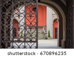 iron gate to the yard   gate to ... | Shutterstock . vector #670896235