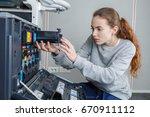 young female technician... | Shutterstock . vector #670911112