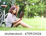 asian woman reading a book in... | Shutterstock . vector #670915426