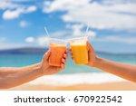 couple toasting healthy juice... | Shutterstock . vector #670922542