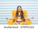 joyful long haired girl... | Shutterstock . vector #670951162