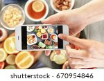 female hands taking pictures of ... | Shutterstock . vector #670954846