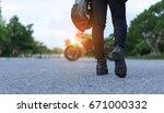 young woman biker holding... | Shutterstock . vector #671000332