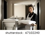 Stock photo maid with housekeeping cart 67102240