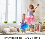 two cute children baby girls... | Shutterstock . vector #671044846