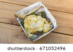 traditional raclette grilled... | Shutterstock . vector #671052496