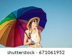 teen girl with umbrella... | Shutterstock . vector #671061952