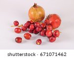 red pomegranates and date... | Shutterstock . vector #671071462