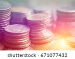 rows of coins for finance and... | Shutterstock . vector #671077432