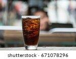 cola in glass background blur   Shutterstock . vector #671078296