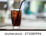 cola in glass background blur   Shutterstock . vector #671080996