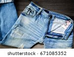 Small photo of Jeans lack and jeans lack pattern texture background, blue jeans texture, jeans lack on the wooden floor