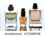 different perfume bottles on... | Shutterstock . vector #671088928