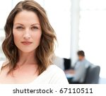 Small photo of Portrait of a charismatic woman at a meeting while her team working in the background