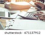 hands holding plastic credit... | Shutterstock . vector #671137912