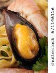 Small photo of Tagliatelle allo scoglio - Typical italian seafood pasta