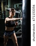 young woman fitness boxing in... | Shutterstock . vector #671153356