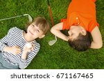 cute children with ball and... | Shutterstock . vector #671167465
