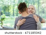 young happy woman hugging her... | Shutterstock . vector #671185342