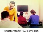 positive american male teacher... | Shutterstock . vector #671191105