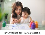 happy family mother and... | Shutterstock . vector #671193856