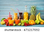 various freshly squeezed fruits ... | Shutterstock . vector #671217052