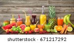 various freshly squeezed fruits ... | Shutterstock . vector #671217292