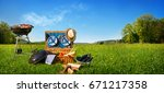 barbecue picnic on a meadow | Shutterstock . vector #671217358