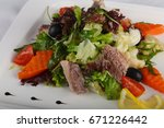 tuna salad with vegetables | Shutterstock . vector #671226442