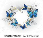 Stock photo jeweled golden heart with blue and white realistic butterflies morpho morpho design with blue 671242312