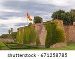 flag of catalonia over montjuic ... | Shutterstock . vector #671258785