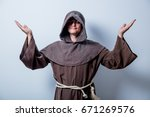 portrait of young catholic monk ... | Shutterstock . vector #671269576
