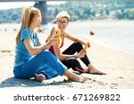 two young women are relaxing on ... | Shutterstock . vector #671269822