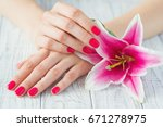 beautiful woman hands with pink ... | Shutterstock . vector #671278975