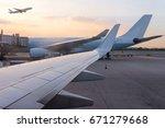 airplane jet waiting to runway... | Shutterstock . vector #671279668