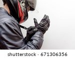 motorcycle guy wearing helmet... | Shutterstock . vector #671306356