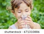 child drinks water. | Shutterstock . vector #671310886