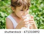 child drinks water. | Shutterstock . vector #671310892