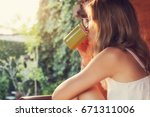 girl drinking coffee   tea and... | Shutterstock . vector #671311006